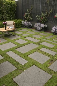 Bluestone slabs and groundcover gives a carpet effect in this cosy courtyard