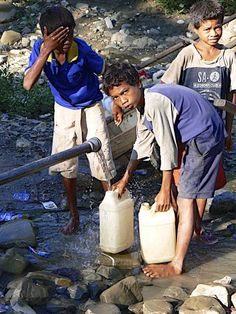 Children fetching water in Covalima, East Timor