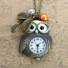 Pocket watch-owl necklace with antique bronze owl design pendant, leaves charm and glass pearl charms. $4.99, via Etsy.