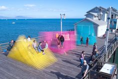 A vibrant pavilion has arrived to grace the boardwalks of California's Santa Barbara waterfront. The pavilion entitled Runaway has been. Villa Architecture, Architecture Diagrams, Architecture Portfolio, Public Architecture, Temporary Architecture, Urban Intervention, Public Space Design, Public Spaces, Playground Design