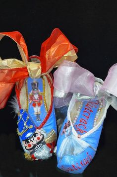 1st pair of pointe shoes customized with her own picture as Clara in the Nutcracker!