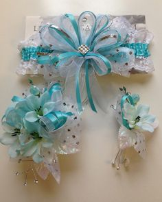 Aqua prom corsage and matching prom garter.  Letsdancegarters.com