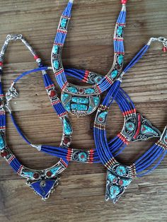 "Imported and Handmade from Tibet Traditional use of Lapis and Turquoise hand strung as beads Coral fragments through out design 16"" * Each design is unique and may vary slightly in shape but will cons"