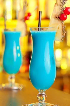 The Blue Hawaiian is similar to the Pina Colada, with rum, pineapple juice and cream of coconut - a little taste of tropical paradise. The big difference is the beautiful ocean blue color. Learn how to make one here! Spicy Recipes, Grilling Recipes, Blue Hawaiian Drink, Blue Hawaii Cocktail, Hawaiian Cocktails, Classic Drink Recipe, Happy Hour, Rumchata Recipes, Recipe Mix