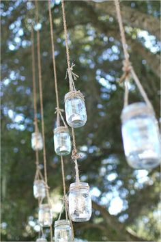 Mason jars. Cute idea!  Would get cuter as dusk sets in & the candles are lit.