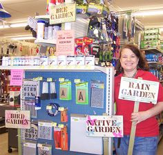 Schnarr's employee Carolyn with several finished signs and a selection of supplies you can use to make one. Carolyn will be demonstrating stenciling at our Ladies' Night on April 30, 2015.