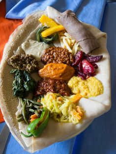 "Ethiopian food is probably best known for the spongy sourdough flatbread called injera , which serves as the ""spoon"" for lentil, bean, meat, and vegetable sauces piled on top. food vegan recipe 17 Delicious Ethiopian Dishes All Kinds Of Eaters Can Enjoy Vegetarian Recipes, Cooking Recipes, Healthy Recipes, Vegetarian Dish, Ethiopian Cuisine, Vegan Ethiopian Recipes, Ethiopian Injera, Ethiopian Lentils, International Recipes"