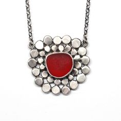 Red sea glass pendant with silver dots by Tania Covo