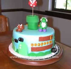 Homemade Mario Brothers Birthday Cake: I let my kids tell me what kind of birthday cakes they wanted this year and my 23 year old told me she wanted a Mario Bros. cake since they are all into