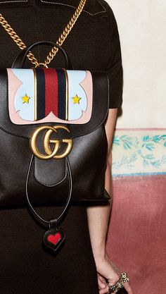 Gucci - Inset with leather hearts and stars, the Marmont's chain strapped shoulder bag and backpack for fall are injected with color and whimsy.