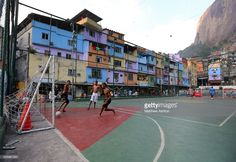 young-boys-play-football-on-the-quadra-futsal-court-in-the-favela-picture-id525987320 (1024×706)