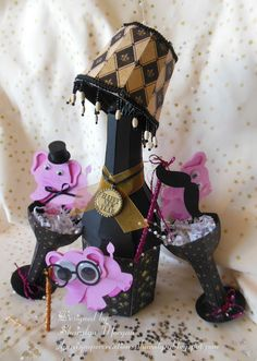 Pink elephants, anyone?!!   Never too early to start thinking about your New Years Eve projects, even if it is a lampshade on a bottle!  Wow, now that's getting creative!  Don't you love the humor Sharalyn brings into her projects!  Definitely makes me smile!  And it is super cute and lots of fun!  Go visit Sharalyn and see what she used  ---   http://sharaspapercreations-sharalyn.blogspot.com/2013/08/pink-elephants-pink-elephants.html