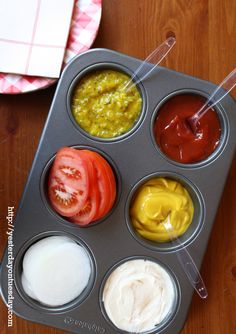 Use a muffin tin to organize condiments like ketchup and mustard.
