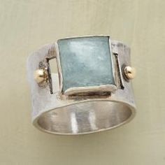 With a bold design and delicate coloring, this aquamarine cabochon & hammered silver ring is a stunner.