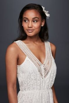 Short and lacy, this crochet-trimmed romper would feel right at home at a bachelorette party, beach ceremony, or reception after-party. Though casual and easy, the elastic-waist style still feels romantic thanks to fluttery eyelash trim and a crisscross bodice.     By Raga  Polyester  Pull-on styling; fully lined  Hand wash  Imported
