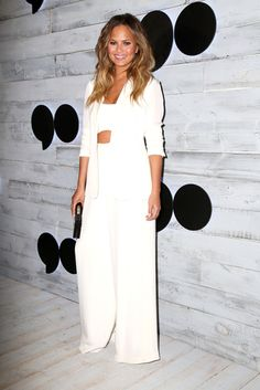 While white skinny pants can look a little vacationy, white wide leg pants, as shown on Chrissy Teigen, are perfect for the winter. For an extra seasonal look, wear them with a chunky sweater on top. Red Lipstick Looks, Long Layered Haircuts, Flowy Pants, Stunning Eyes, Long Hair Cuts, Bad Hair Day, Skin Tight, Facial Hair, Hair Hacks