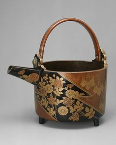 Wine Ewer with Design of Chrysanthemums and Paulownia Crests in Alternating Fields  Period: Momoyama period (1573–1615) Date: ca. 1596 Culture: Japan Medium: Lacquered wood with sprinkled gold (makie) decoration in Kôdai-ji style
