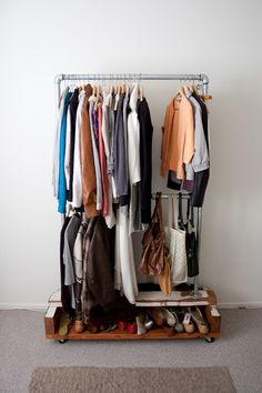 { such a cool rolling clothes/shoes/purse rack. a closet on wheels.  check out the blog post: http://plhnk.blogspot.com/2010/10/clothes-rack.html }