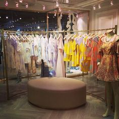 Like the idea of having one of the fitting room benches move onto the floor, perhaps in front of a shoe column. Fashion Store Display, Store Displays, Matilda, Fashion Retail Interior, Dressing Room Closet, Storing Clothes, Resale Store, Boutique Interior, Consignment Shops