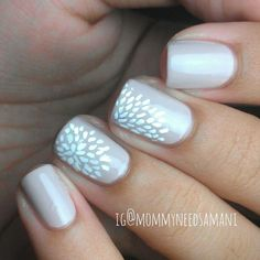 Really subtle pretty off white nails with white flowers