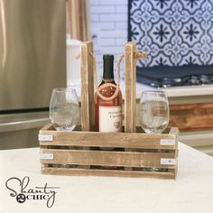 Check out this simple and fun DIY Woodworking project! It's a DIY Wine Caddy that will hold a bottle of wine and two glasses, or 3 bottles of wine!