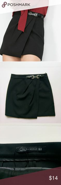 Zara black skirt with buckle In excellent used condition. Only worn once.  Pleated crossover body.   Extra small   Length 16 in  Waist 27 in  Material :  64% polyester  32 % viscose  4% elastin   All reasonable offers considered! Zara Skirts Mini