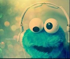 Cookie Monster jamming to his fave tunes