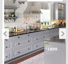Here is one of out kitchen ideas. IKEA grey kitchen cabinets, dark countertop, white backsplash.