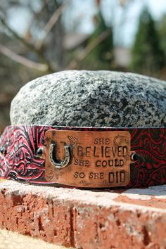 """Handmade """"She Believed She Could, so She Did"""" metal bracelet on Black/Red Tooled Leather Cuff on Etsy, $50.00"""