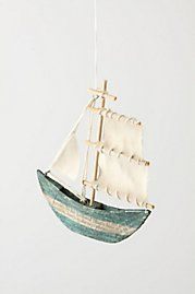 I want ALL of the ornaments from Anthropologie and I want them hanging from the ceiling in my bedroom.  Especially the sailboat and octopus!!!!!