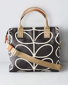 Orla Kiely's shoulder bag converts in an instant to a cross-body messenger, perfect for when your schedule whisks you from work to workout. Crafted of durable, easy-clean materials, in her iconic, playful prints.