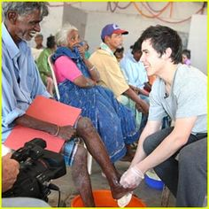 Washing the feet of the people with leprosy ~India trip for Rising Star Outreach changed David's  life.