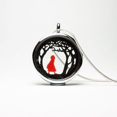This tiny double layered papercut depicts Little Red Riding Hood walking through the forest. The entire dual layered papercut measures no more than 30 mm and is displayed in a gorgeous glass floating locket pendant. Victorian Style Clothing, Floating Lockets, White Gift Boxes, Cute Diys, Dainty Jewelry, Red Riding Hood, Diy Necklace, Paper Cutting, Jewelry Design