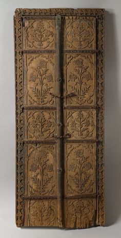 The flower style associated with the height of Mughal aesthetics and refinement finds expression in this pair of carved wood doors. The depiction of complete flowering plants, carved in low relief and placed in a symmetrical arrangement, is the hallmark of this style, which had its genesis in the reign of the Mughal emperor Jahangir (1605–27