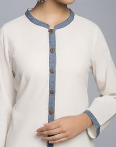 Flaunt a nonchalant look when you wear this cotton khadi kurta featuring contrast placket. Pair it with our range of ijar pants or churidars for a smart look. Cotton Khadi Chinese Collar Full Sleeves Hand Wash Separately in Cold Water