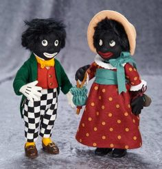 """11"""" American felt characters,""""Miss Golli"""" and """"Golliwogg"""", Collector's Club by R John WrightGolliwogg Marks: RJW (brass button) Golliwogg No. 0090/2500 (paper label), includes collector's club certificate of authenticity and original box.  R John Wright, circa 1996."""