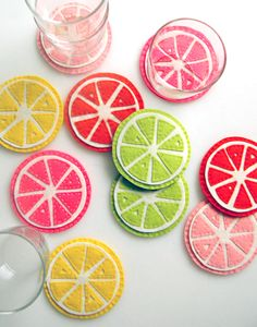"To get started, gather your supplies: 5 8x12"" sheets of various citrus colored felt 2-3 8x12"" sheets of white felt embroidery thread to match your felt scissors citrus coaster template (available for free download from The Purl Bee)"