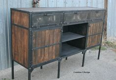 Thank you for taking a moment to view my work. This is a vintage industrial style buffet/sideboard credenza. It is made of steel, and reclaimed wood