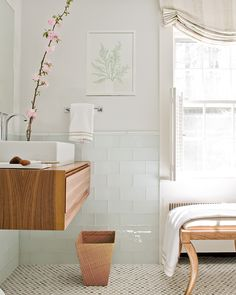 glass tile wall treatment + floating wood vanity