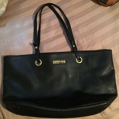 Kenneth Cole Reaction bag Used in good condition the strap is worn shown in the pic color is black and the size is large Kenneth Cole Reaction Bags