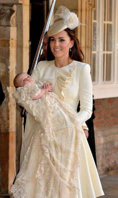 The Duchess of Cambridge carries her son Prince George after his christinening