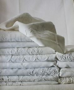 my dream linen closet. embroidered antique linens