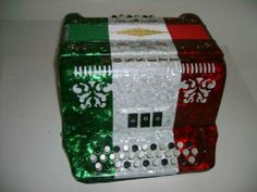 Rossetti 34 Button Accordion 12 Bass, 3 Switch, Case & Straps, GCF, Tri-Color: Red/White/Green by Rossetti. $407.00. Features:   Rosetti Button Accordion  Diatonic - three switch  Key of G-C-F  Italian style decorations  Bright pearlescent colors  Custom grill design  Finish: Tri-Color Red-White-Green  12 Bass buttons  34 Treble buttons  3 switches  20 fold sheepskin bellows with reinforced corners for longer life  Slide lever air intake valve  Includes hard shell locking c...