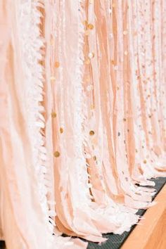 REVEL: Pink Gold Streamer Backdrop PRICE: $3.12 per roll DESCRIPTION: Create a festive backdrop by layering various shades of pink crepe streamers with gold circle garland! Image: Glitter + Gold