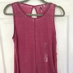 Calvin Klein Sleeveless Shirt Gorgeous deep berry, NWT sleeveless top. Peep hole in back. Super soft and great with a pair of dark jeans. Calvin Klein Tops Tank Tops