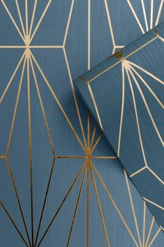 This Kayla Geometric Wallpaper features a geometric pattern of elongated triangles with a metallic bronze finish on a deep blue background with a lined texture Hallway Wallpaper, Art Deco Wallpaper, Pattern Wallpaper, Metallic Wallpaper, Geometric Wallpaper Living Room, Blue Wallpaper Bedroom, Interior Design Living Room, Living Room Decor, Bedroom Decor