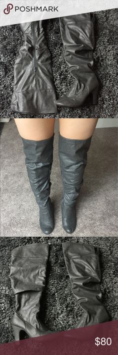 Gray Thigh High Slouch Leather Boots - SIZE 9.5 THESE BOOTS WERE MADE FOR WALKIN'! Gray leather thigh high over the knee heeled boots. Purchased from a Las Vegas boutique. GREAT CONDITION: only worn ONCE indoors, damage to soles is very minimal. Slight wear as shown in pictures, but very unnoticeable as it blends with color when worn. I have big calves / thighs and these fit me like a glove! Also wide foot friendly! So extremely comfortable! Shoes Over the Knee Boots