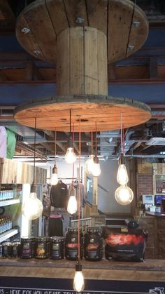 Lighting suspended from cable reel. #rustic #reclaimed #shabbychic #repurposed