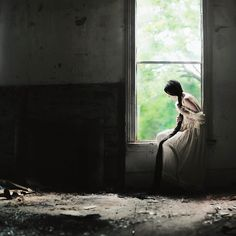 https://flic.kr/p/9X77qJ | The girl who looked out at the world. | 350/365.  I shot this in the abandoned house in which we spent the entire day. Ashley slathered me in mud (again) for her photographs, so I returned the favor with a giant smoke bomb blast to the face and lungs (in a photo that I might post eventually). This photo was spur of the moment, and I gotta say that I really like it.  Day 1 of the flickr gathering is tomorrow! We'll be up late tonight finishing props and clothing…