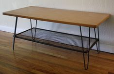This is a beautiful mid century modern coffee table with authentic hairpin legs. It has authentic mcm hairpin legs, a cast iron mesh shelf, and an mcm formica top. Gorgeous contrast, and design. Dimensions: x x *SOLD* Gold Glass Coffee Table, Coffee Table 2019, Iron Coffee Table, Modern Table Legs, Modern Coffee Tables, Hairpin Leg Coffee Table, Hairpin Legs, Iron Shelf, Mid Century Modern Design